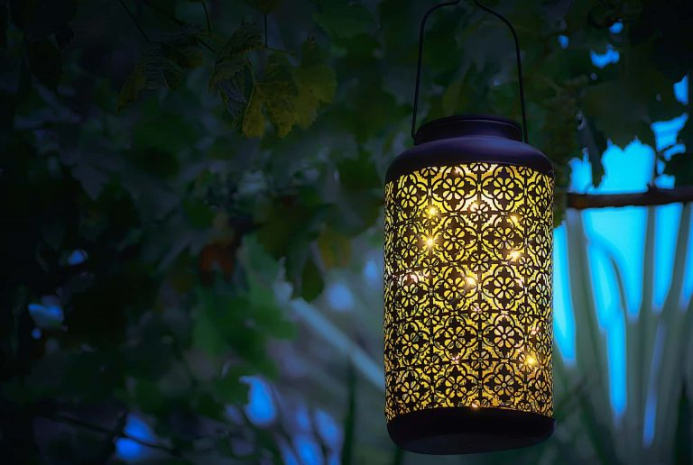 metal lantern hanging from balcony