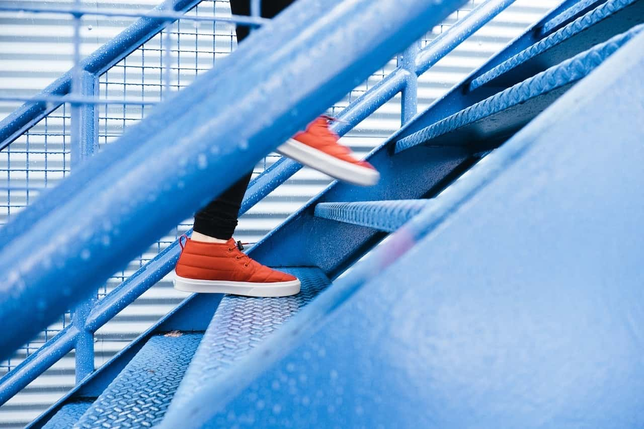 walking up the designer stairs
