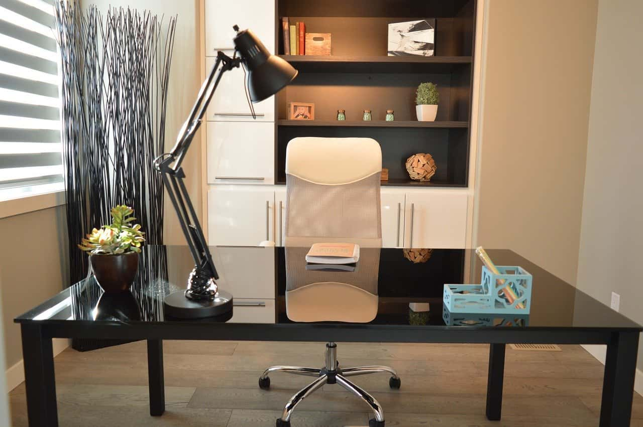 image of office desk with table lamp